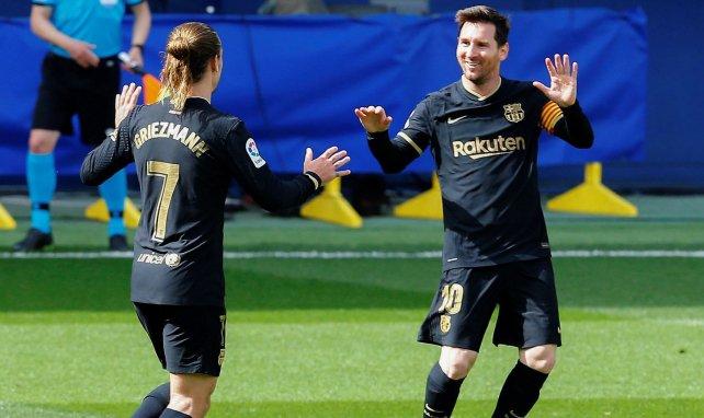 Antoine Griezmann celebra una de sus dianas con Lionel Messi