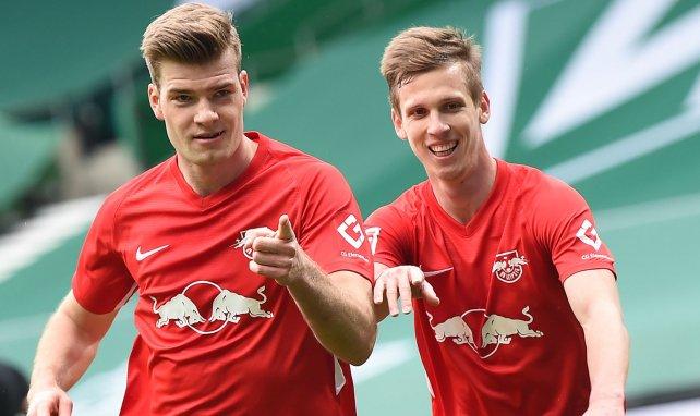 Alexander Sorloth y Dani Olmo celebran una diana del RB Leipzig